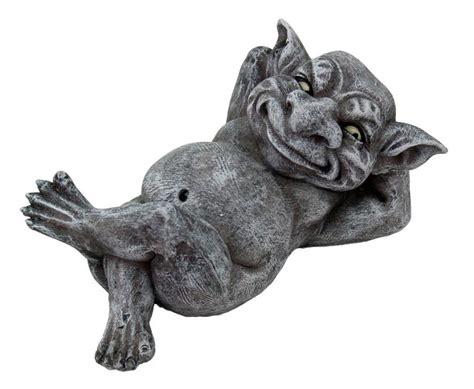 grotesque smiling gargoyle figurine statue style