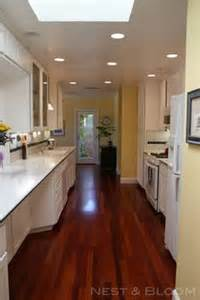 Oak Kitchen Makeover Pictures - kitchen makeover white cabinetry brazilian cherry floor