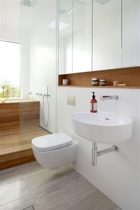 bathroom mirror with storage inside small bathroom with wall hung basin and toilet mirrored