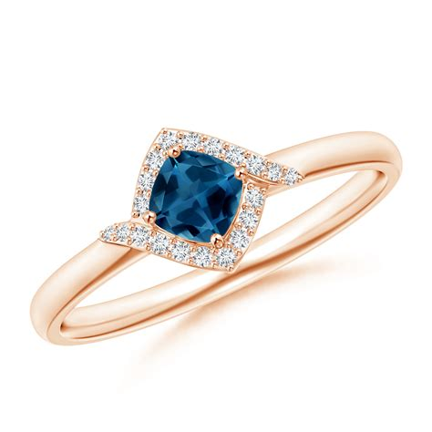 cushion blue topaz and halo promise ring