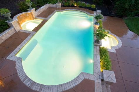 night view of roman style swimming pool with deck jets grecian style for your own roman themed swimming pool