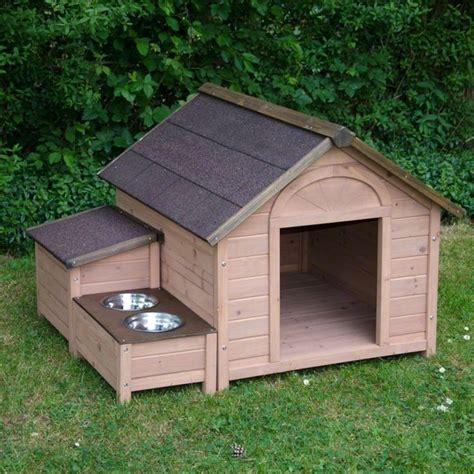 backyard dog enclosures casitas de perro con platos de comida a un costado
