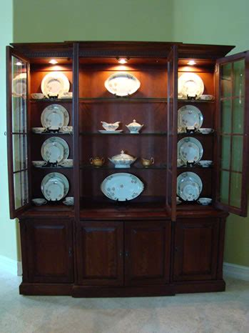 how to decorate your china cabinet the of accessorizing a china cabinet matt and shari