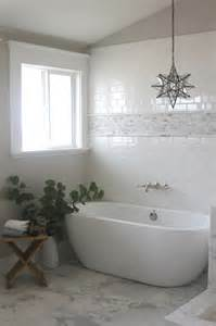 gorgeous bathroom with subway tiled wall bordered with a