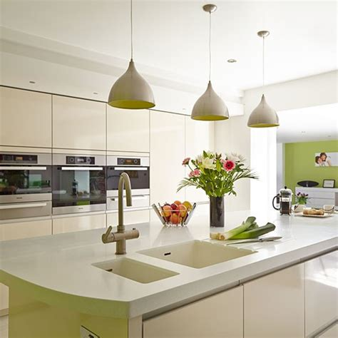 Hanging Kitchen Cabinets From Ceiling by Modern White Kitchen With Island And Pendant Lights