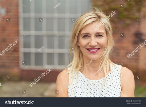 this pretty blond haired middle aged stock photo 86043952 beautiful blonde middle aged woman with medium length