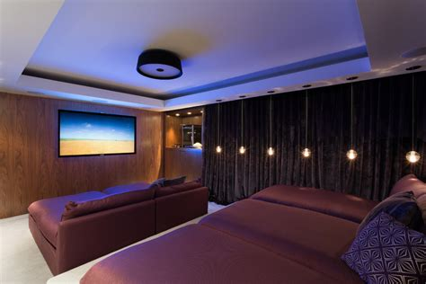 media room chaise lounges cinema room home theater contemporary with movie posters