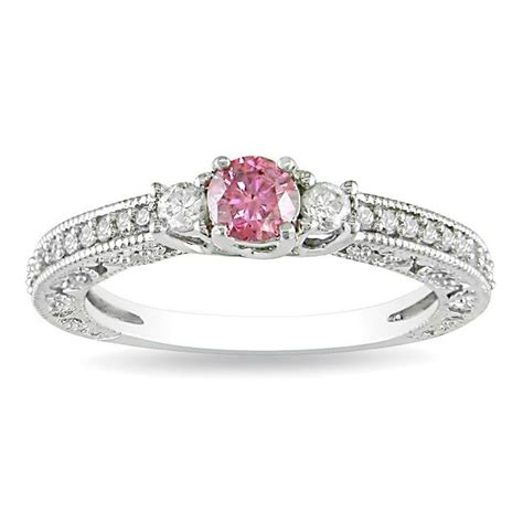 pink sapphire with three engagement ring