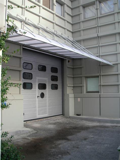 tettoie per portoni tiranti pensilina in alluminio con policarbonato