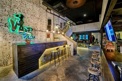 village pop tattoo qg studio by archetype design studio chengdu
