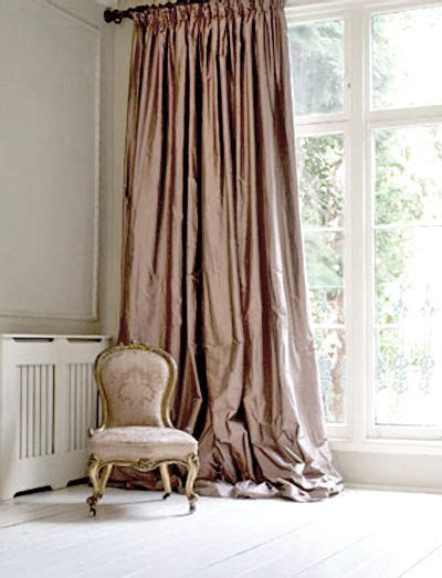 hanging curtains high and wide how to hang curtains the 2 rules you need for drapery