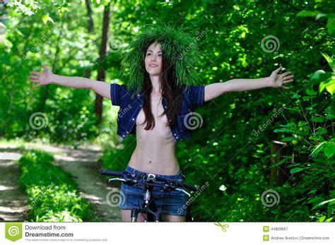 0008288607 the girl in the woods girl in the woods on the bike is happy stock image image