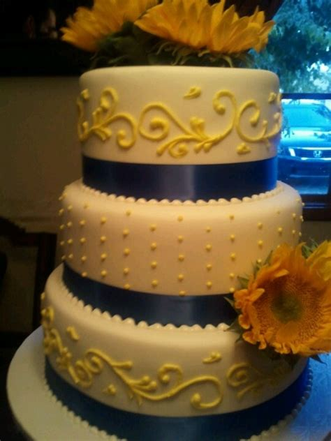 blue and yellow wedding cupcakes royal blue and yellow wedding cake maybe better