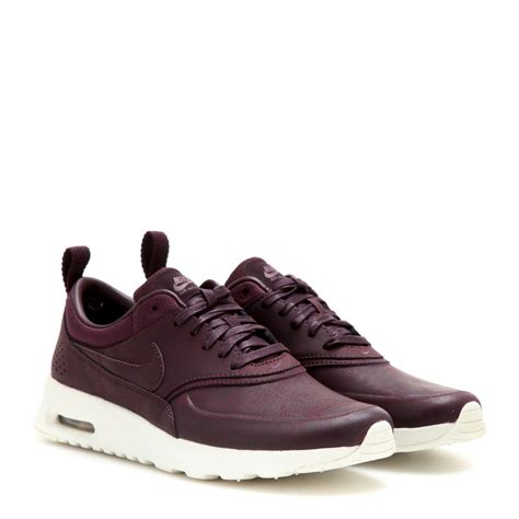 nike thea sneakers nike air max thea premium sneakers in purple lyst