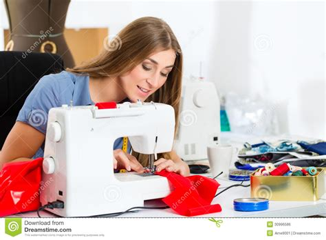 clothes design machine fashion designer or tailor working in studio royalty free