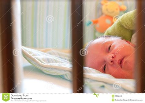 baby sleeping in crib stock photos image 13886183