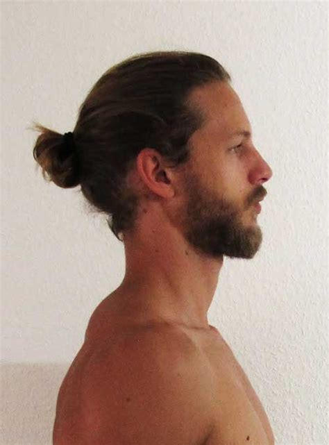 shave sides man bun hairstyle shaved in at sides and back long on top