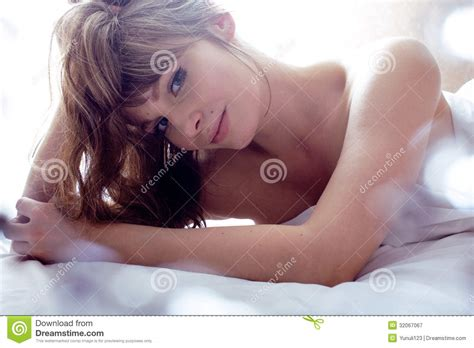 pretty blond laying in bed royalty free stock
