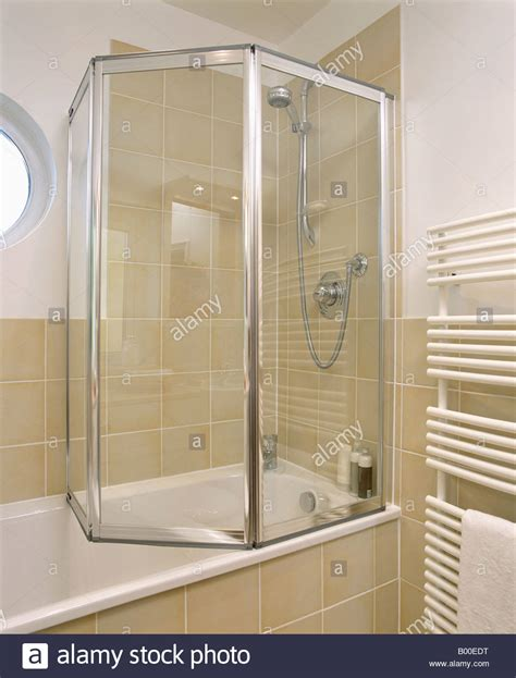 Glass Bath Shower Doors Folding Glass Shower Doors On Bath In Modern Bathroom With Neutral Stock Photo Royalty Free