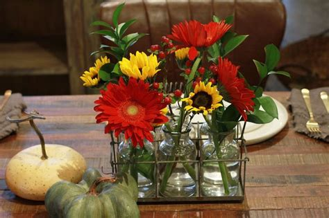 Unique Vases For Centerpieces by Flowers In Small Jars Or Vases To Create A