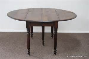 antique oak 5 leg drop leaf dining table