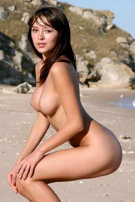 On The Beach A Gorgeous Girl With Perfect Breasts Hangs