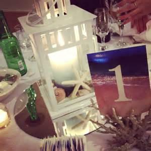 Lantern Centerpieces For Weddings Diy Beach Lantern Centerpiece We Make Stuff Pinterest Graphics Seashells And Lanterns
