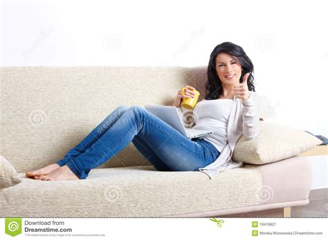 y girl on couch beautiful young woman relaxing on sofa stock image image