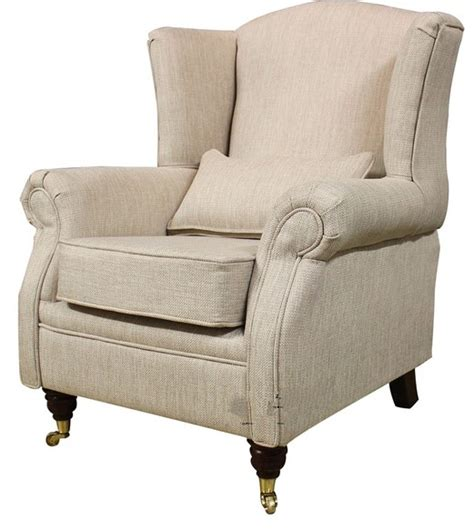 Armchairs Uk by Wing Chair Fireside High Back Armchair Zoe Plain Biscuit