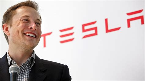 tesla ceo elon musk confirms talks with apple but says