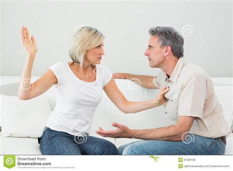 Free Living Room Fighting Angry About To Slap A At Home Stock Photo