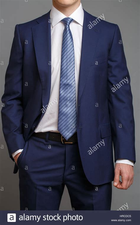 light blue shirt with tie in blue tuxedo with light blue tie and white shirt