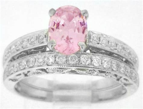 light pink sapphire engagement ring and matching wedding
