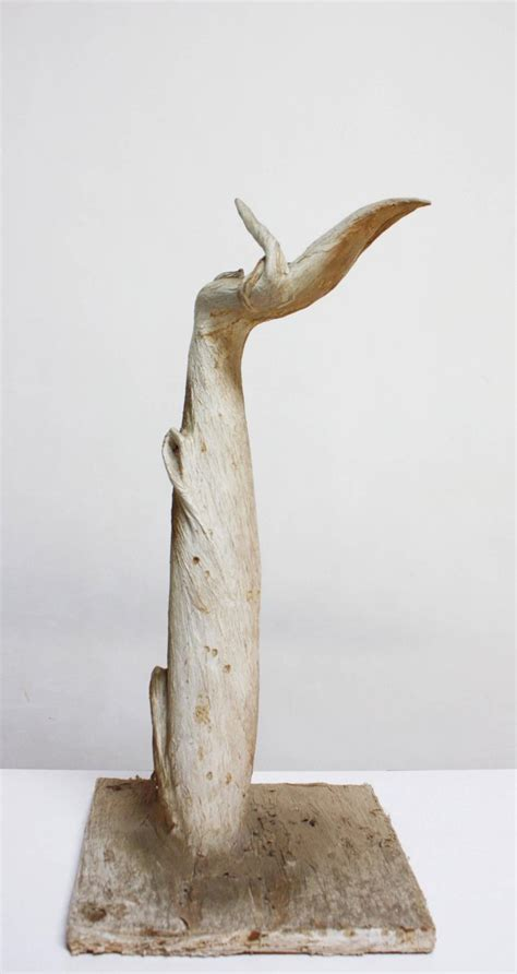 petrified and painted tree branch sculpture on