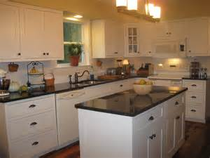 White Kitchen Cabinets With Brown Countertops Shiloh Cabinets With Inset Doors In Soft White Coffee Brown Granite Countertops And Shepard S