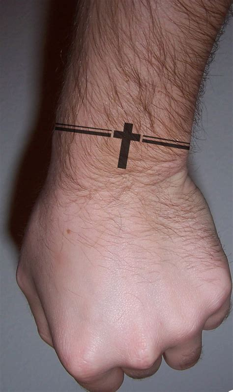 mens small arm tattoos cross bracelet idea
