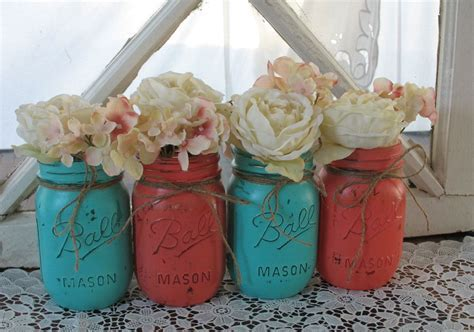 This is a SET OF 4 hand painted mason jars. Two of each