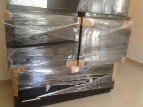 how to wrap a couch for moving cardboard and shrink wrap to protect furniture how to