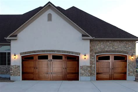 Door For Garage To House by Carriage House Garage Doors