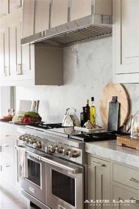 Light Grey Cabinets In Kitchen Light Grey Kitchen Cabinets With Marble Slab Backsplash Transitional Kitchen