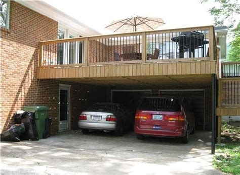 garage for cars carport with deck above in front of the garage perfect