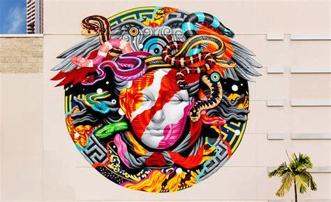 street artist reinterprets versaces iconic logo