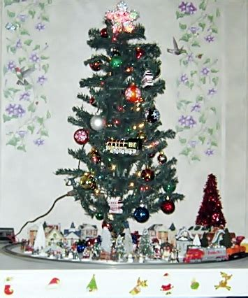 toy that goes around christmas tree trees and trains go together this week in the world of toys