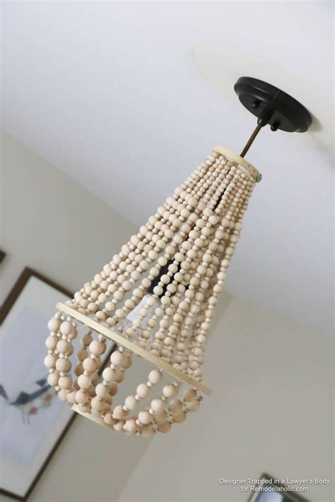 wood bead chandelier how to make a wood bead chandelier remodelaholic