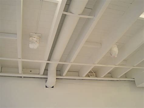 painted white color unfinished basement wood ceiling design combined with pipe ideas