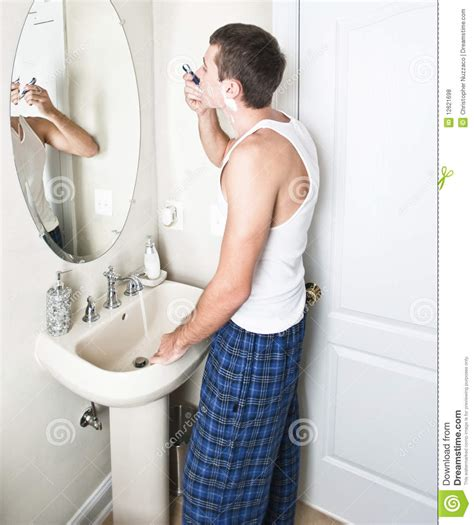 shaving bathroom young man in bathroom shaving stock photo image 12621698