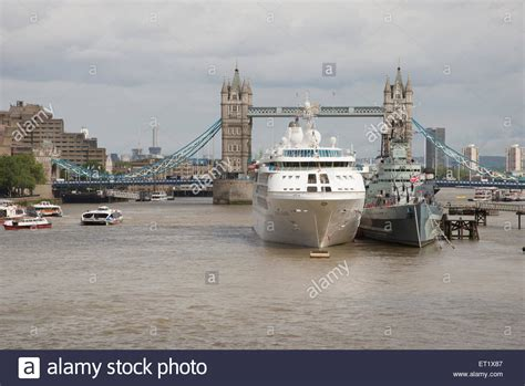 thames river shipyard cruise ship berthed next to hms belfast on the river