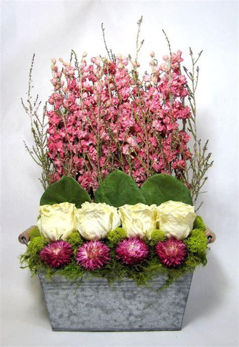dried floral arrangement stacked flower arrangement