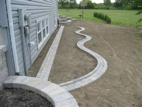 Natural Stone Driveway paver edging simons landscaping chesterton in