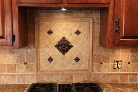 kitchen tile work backsplash center piece with metal